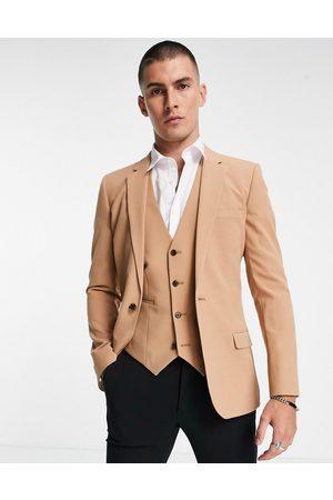ASOS DESIGN Super skinny suit jacket in camel
