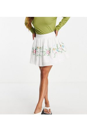 Reclaimed Vintage Inspired mini skirt with cross stitch embroidery in white co