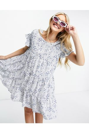 QED London Tiered smock dress in blue floral print