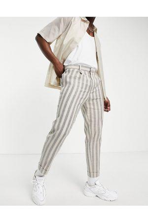 ASOS DESIGN Tapered stripe smart trousers in ecru linen