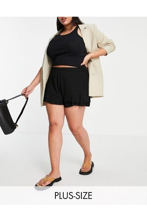 Yours Shorts with frill hem in black