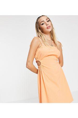 Collusion Cut out side mini dress in orange