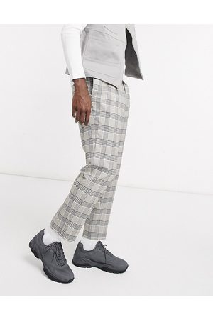 ASOS DESIGN Tapered smart trousers in stone check