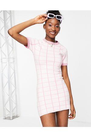 Liquorish Knitted mini dress with split in pink check