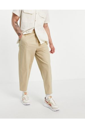 ASOS DESIGN Oversized tapered chinos in
