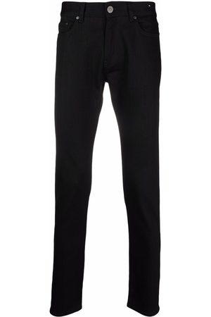 PT05 Skinny jeans con tiro alto