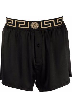 VERSACE Pantalón de pijama de seda con borde Greca