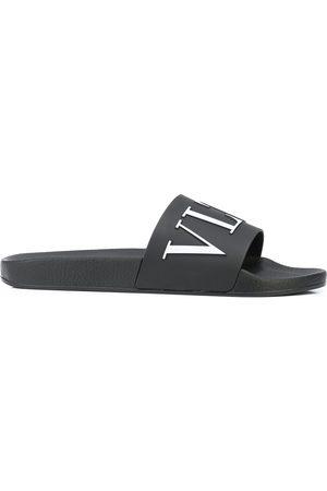 VALENTINO GARAVANI Flip flops con logo estampado