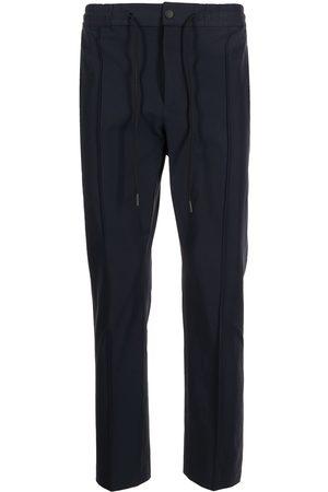 PT01 Pantalones tipo gabardina de corte slim