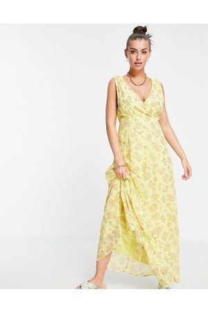 VILA Maxi dress with wrap front detail in yellow floral