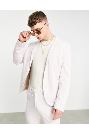 ASOS Super skinny suit jacket in pink jersey