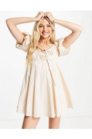 Skylar Rose Babydoll mini dress with strap detail in cream