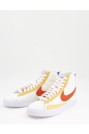 Nike Blazer Mid 77 trainers in off white sunset tones
