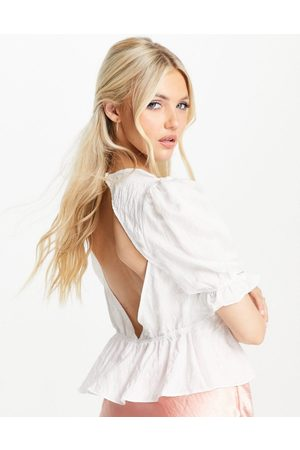 Skylar Rose Puff sleeve open back top in off white
