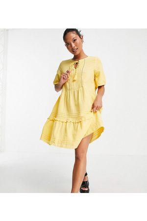 Vero Moda Petite Organic cotton tiered smock dress with tie neck in yellow