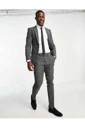 ASOS DESIGN Wedding skinny wool mix suit jacket in charcoal herringbone