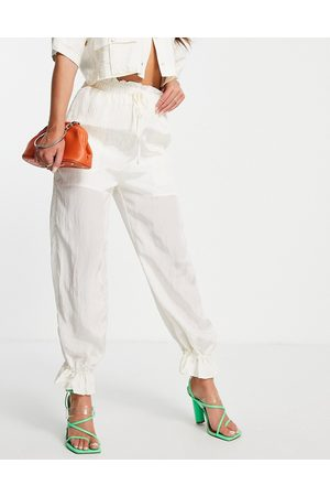 Ghospell Trousers with cuffed detail in cream co