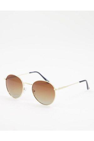 ASOS DESIGN Metal round sunglasses with grad brown polarised lens in gold