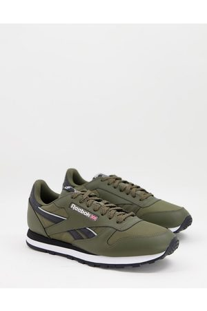 Reebok Classic Leather trainers in khaki and black