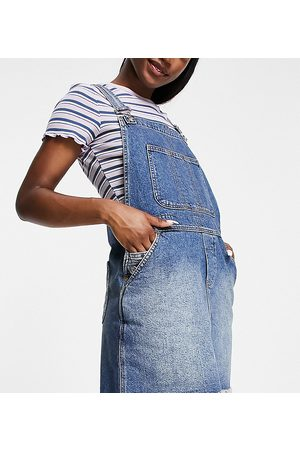 Reclaimed Vintage Inspired dungaree denim mini skirt in authentic blue wash