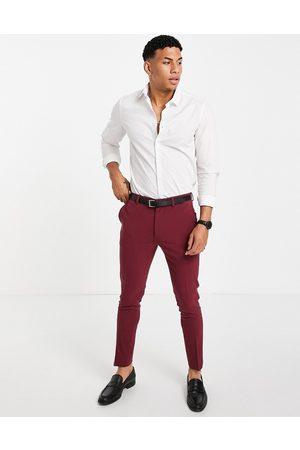 ASOS Super skinny suit trousers in burgundy