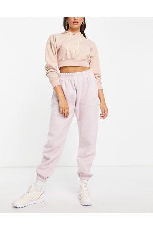 Reebok Fleece joggers in pastel pink