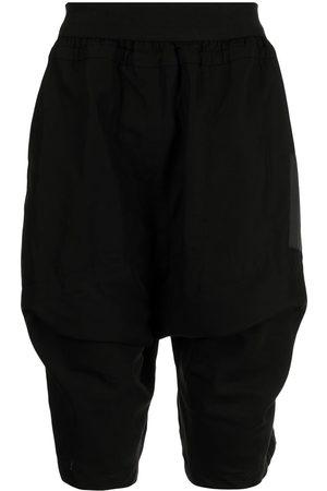 JULIUS Shorts con bolsillos y solapa