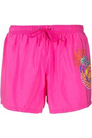 Moschino Hombre Shorts - Shorts de playa con estampado gráfico