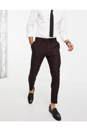 ASOS Hombre Slim y skinny - Wedding super skinny wool mix suit trousers in burgundy twill