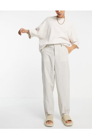 ASOS DESIGN Oversized tapered trousers in linen look stripe