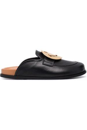 JOSHUA SANDERS Smiley-buckle leather slippers