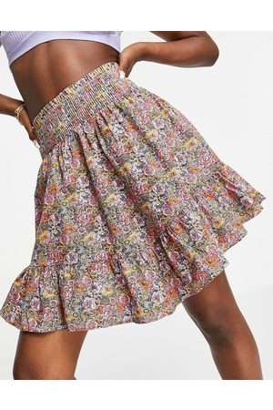 Y.A.S Organic cotton tiered shirred detail mini skirt in pink floral