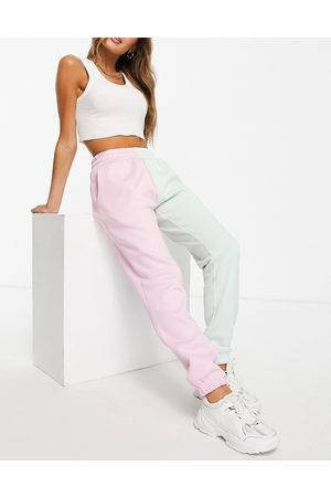 Chelsea Peers Lounge half and half joggers with tie waist in pink and green