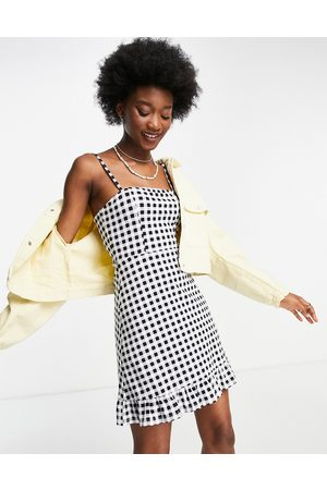 ASOS Strappy sundress with pep hem in black and white gingham