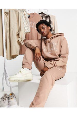 Nike Unisex Vintage logo fleece oversized hoodie in washed brown