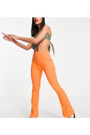 COLLUSION Seam split legging flare in orange