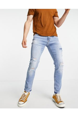 River Island Skinny jeans with rips in light blue