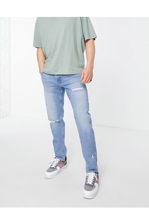 ASOS Hombre Skinny - Stretch slim jeans in mid wash with rips