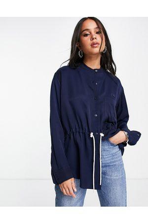Lacoste Tie waist collarless shirt in blue