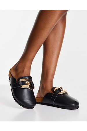 ASRA Fiscal clogs in black with chain detail