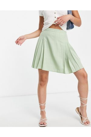 Lola May Pleated tennis mini skirt in green check