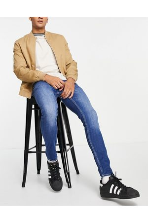 New Look Hombre Skinny - Super skinny jeans in washed mid blue