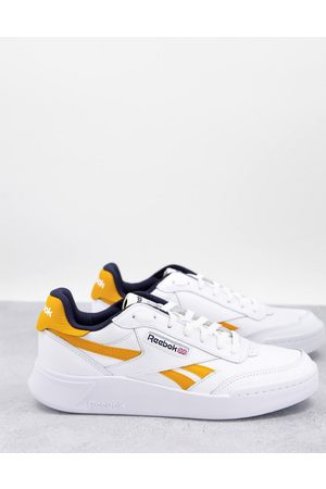 Reebok Club C Legacy Revenge trainers in white and yellow