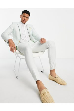 ASOS Wedding super skinny suit trousers in pastel green cotton linen
