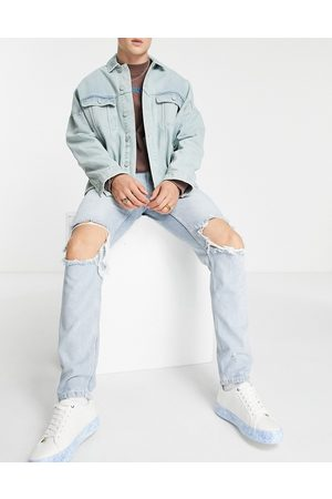ASOS Slim jeans in light wash with extreme knee rips
