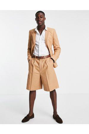 ASOS Wide leg bermuda shorts in tan cotton linen