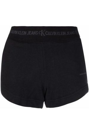 Calvin Klein Mujer Shorts - Shorts deportivos con logo en la pretina