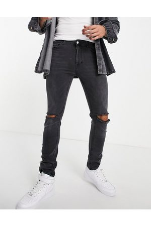 Religion Slim tapered leg jeans in grey with rips