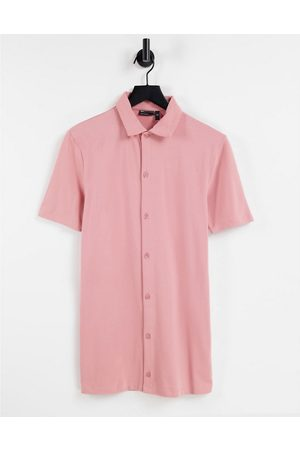 ASOS DESIGN Hombre Manga corta - Organic muscle fit button through jersey shirt in washed pink