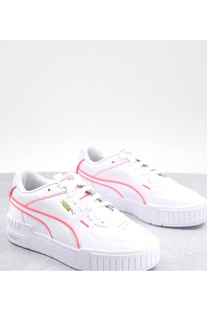 PUMA Cali Sport trainers in white with neon pink piping